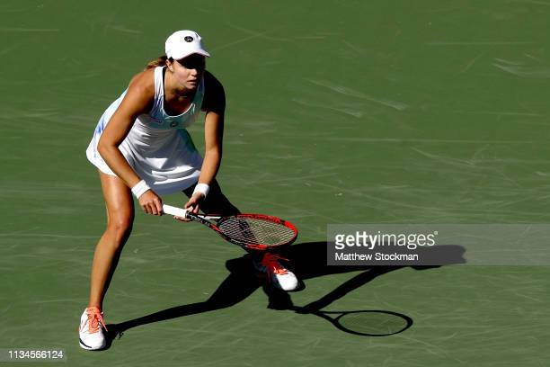 Stefanie Voegele of Switzerland plays Sloane Stephens during the BNP Paribas Open at the Indian Wells Tennis Garden on March 08, 2019 in Indian...