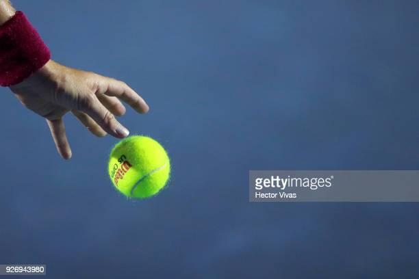 Stefanie Voegele of Switzerland prepares a serve during a semifinal match between Stefanie Voegele of Switzerland and Rebecca Peterson of Sweden as...