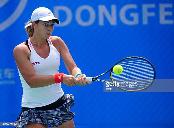 Stefanie Voegele of Switzerland returns a ball in the qualifying match against Bethanie Mattek-Sands of the United States prior to the start of 2014...