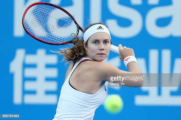 Stefanie Voegele of Switzerland returns a shot during her qualifying match against Veronika Kudermetova of Russia during 2017 WTA Shenzhen Open at...