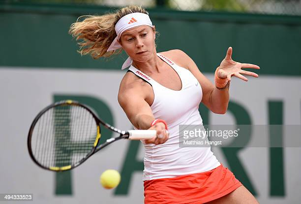 Stefanie Voegele of Switzerland returns a shot during her women's singles match against Andrea Petkovic of Germany on day five of the French Open at...