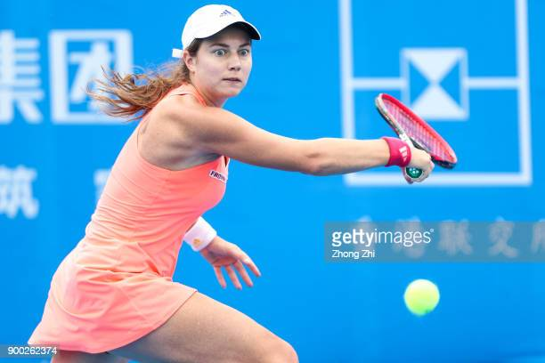 Stefanie Voegele of Switzerland returns a shot during the match against Ekaterina Alexandrova of Russia during Day 2 of 2018 WTA Shenzhen Open at...