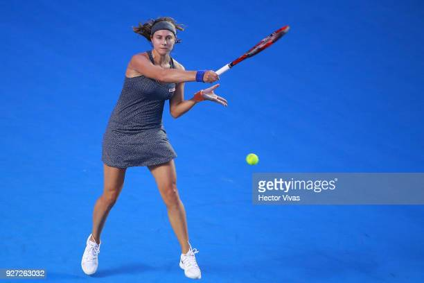 Stefanie Voegele of Switzerland returns a shot during the Championship match between Stefanie Voegele of Switzerland and Lesia Tsurenko of Ukraine as...