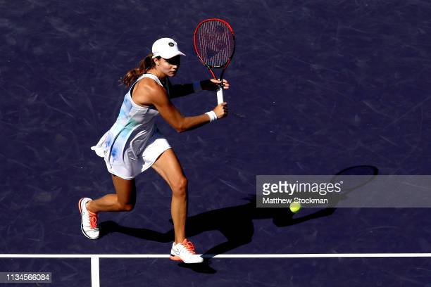 Stefanie Voegele of Switzerland returns a shot to Sloane Stephens during the BNP Paribas Open at the Indian Wells Tennis Garden on March 08, 2019 in...