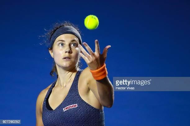 Stefanie Voegele of Switzerland serves during the Championship match between Stefanie Voegele of Switzerland and Lesia Tsurenko of Ukraine as part of...