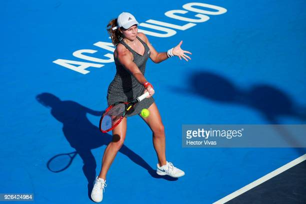 Stefanie Vogele of Switzerland takes a forehand shot during the match between Sloane Stephens of USA and Stefanie Vogele of Switzerland as part of...