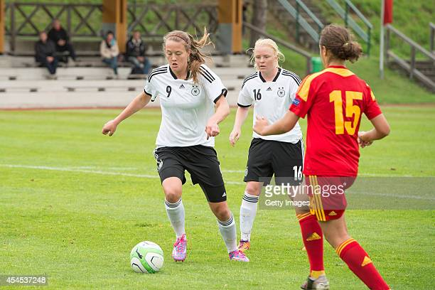 StefanieAntonia Sanders and Jule Dallmann of Germany challenges Diana Cristina Grecu of Romania during the international friendly match between U17...