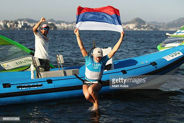 Stefaniya Elfutina of Russia celebrates after finishing third overall in the Women's RSX class on Day 9 of the Rio 2016 Olympic Games at the Marina...