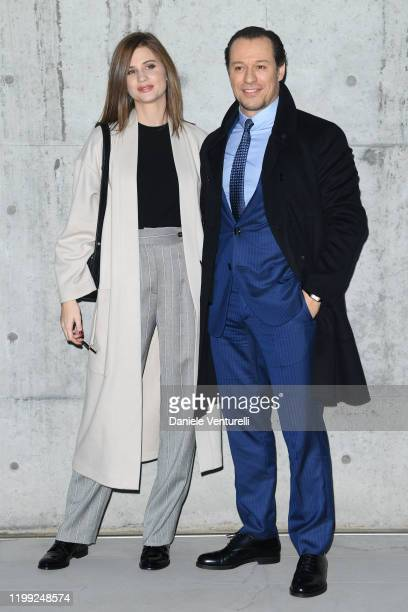Stefano Accorsi and Bianca Vitali Accorsi attend the Giorgio Armani fashion show on January 13 2020 in Milan Italy