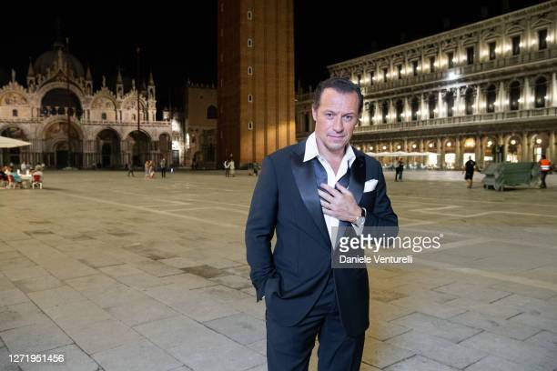 Stefano Accorsi poses for the photographer at the 77th Venice Film Festival on September 10, 2020 in Venice, Italy.