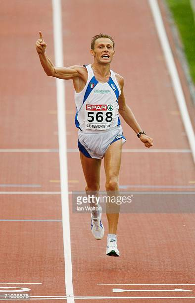 Stefano Baldini of Italy celebrates as he crosses the line to win gold during the Men's Marathon on day seven of the 19th European Athletics...