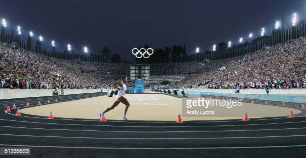 Stefano Baldini of Italy rounds the last turn in the stadium before finishing first to win the gold medal in the men's marathon on August 29, 2004...