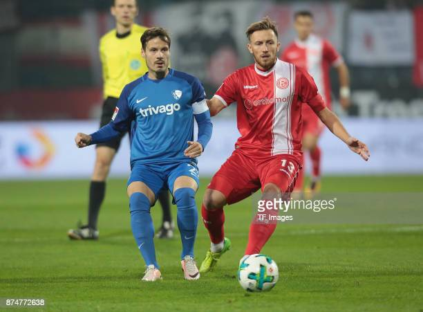 Stefano Celozzi of Bochum and Adam Bodzek of Duesseldorf battle for the ball during the Second Bundesliga match between VfL Bochum 1848 and Fortuna...