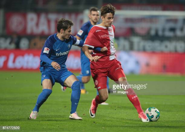 Stefano Celozzi of Bochum and Florian Neuhaus of Duesseldorf battle for the ball during the Second Bundesliga match between VfL Bochum 1848 and...