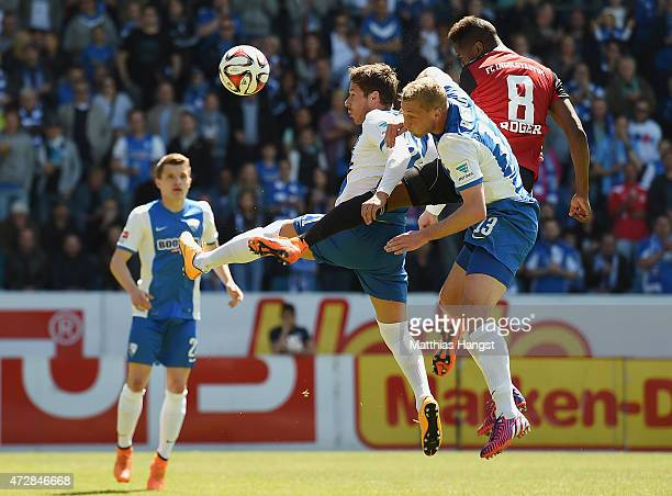 Stefano Celozzi of Bochum jumps for a header with Felix Bastians of Bochum and Roger of Ingolstadt during the Second Bundesliga match between VfL...