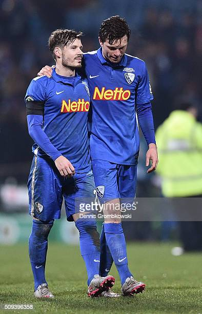 Stefano Celozzi of VfL Bochum and Tim Hoogland of VfL Bochum look dejected following the final whistle during the DFB Cup quarter final match between...