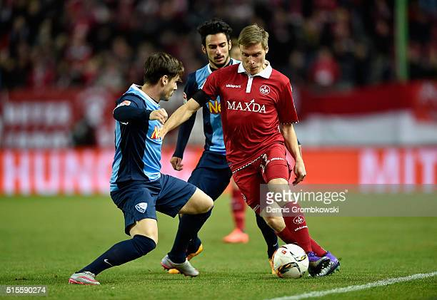 Stefano Celozzi of VfL Bochum challenges Ruben Jenssen of 1 FC Kaiserslautern during the Second Bundesliga match between 1 FC Kaiserslautern and VfL...
