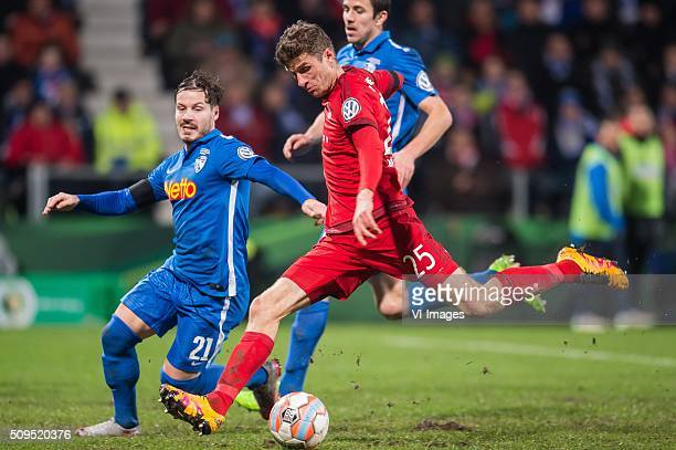 Stefano Celozzi of VFL Bochum Thomas Muller of Bayern Munich during the Bundesliga match between VfL Bochum and Bayern Munich on February 4 2016 at...