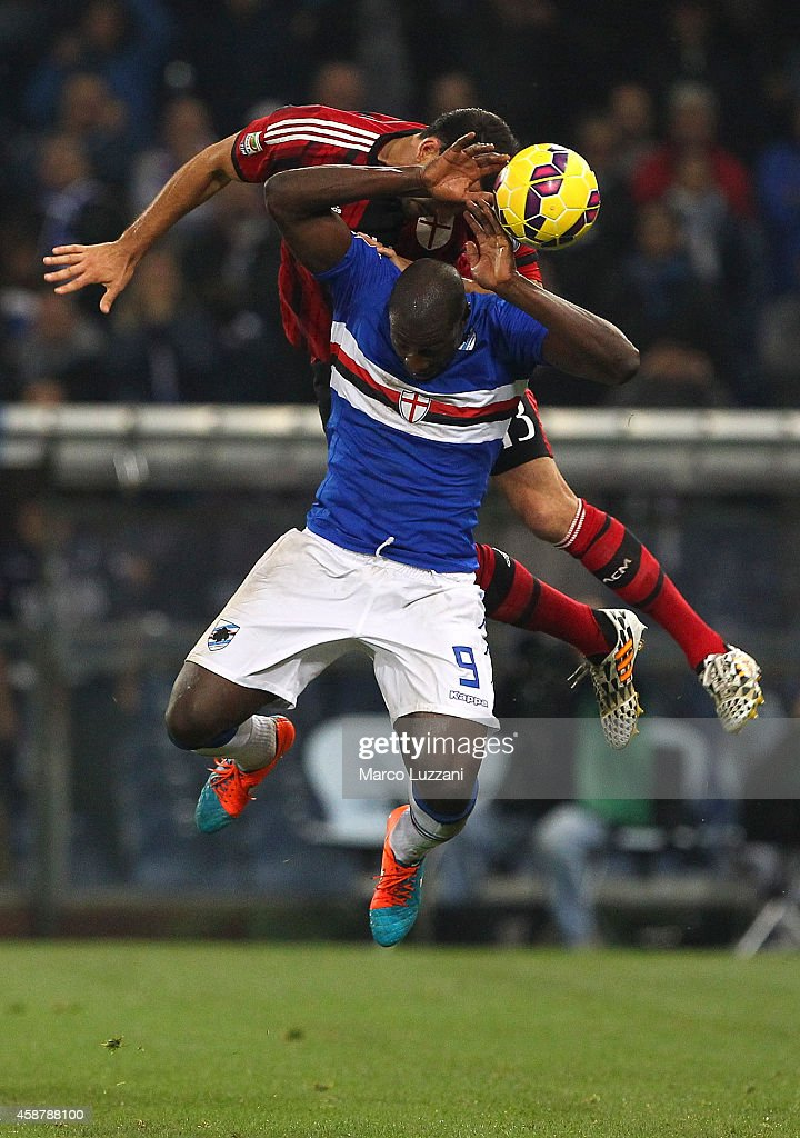 Stefano Chuka Okaka (down) of UC Sampdoria competes for the ball with Adil Rami (up) of AC Milan during the Serie A match between UC Sampdoria and AC Milan at Stadio Luigi Ferraris on November 8, 2014 in Genoa, Italy.