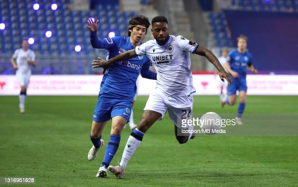 Stefano Denswil of Club Brugge battles for the ball with Junya Ito of KRC Genk during the Jupiler Pro League Champions' play-offs match day 2 between...