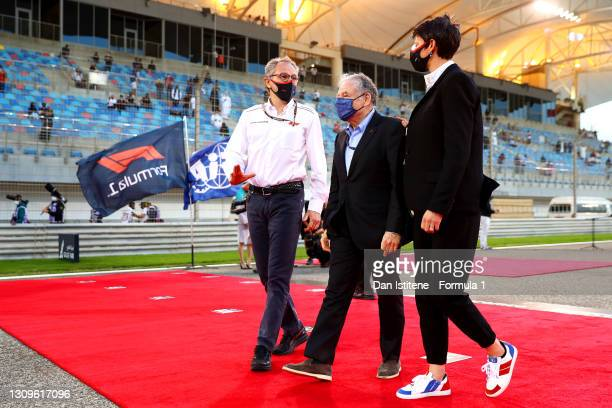 Stefano Domenicali, CEO of the Formula One Group, talks with FIA President Jean Todt on the grid before the F1 Grand Prix of Bahrain at Bahrain...