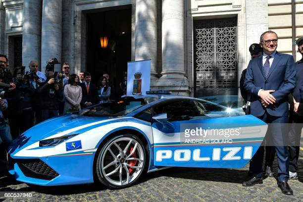 Stefano Domenicali Chief Executive Officer of Automobil Lamborghini stands next to the new police's car Lamborghini 'Huracan' during a press...
