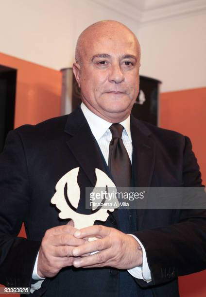 Stefano Dominella fashion house Gattinoni's president shows his award during the '2009 Margutta Awards' at Margutta RistoArte on November 24 2009 in...