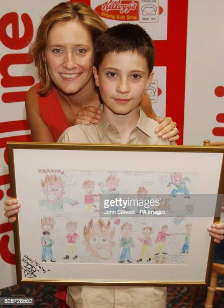 Stefano Facchini from Kilmarnock Ayrshire with BBC TV news presenter Sophie Raworth and his award winning cartoon which he entered in the Childline...
