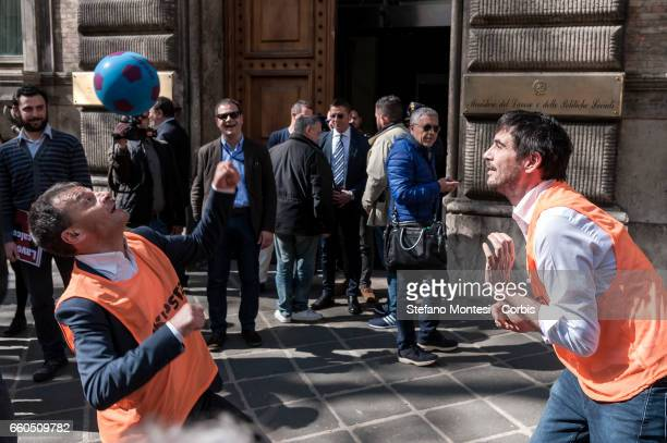 Stefano Fassina deputy Left Italian party plays with a ball with Nicola Fratoianni, secretary of the Left Italian party as they protest in front the...