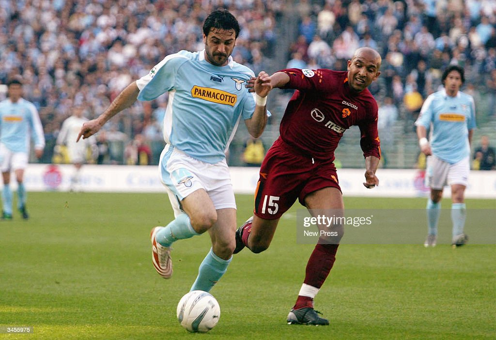 Stefano Fiore (L) fends off Olivier Dacourt during the Serie A match between Roma and Lazio on April 21, 2004 in Rome Italy. The match ended in a 1-1 draw. (Photo by Newpress/Getty Images).