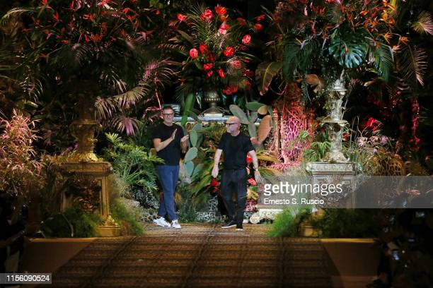 Stefano Gabbana and Domenico Dolce acknowledge the applause of the audience on the runway at the Dolce & Gabbana fashion show during the Milan Men's...