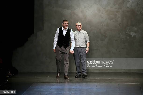 Stefano Gabbana and Domenico Dolce acknowledge the applause of the audience after the runway at the Dolce & Gabbana fashion show as part of Milan...