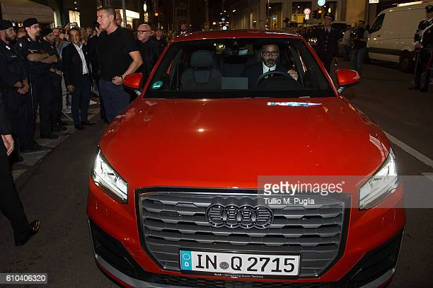 Stefano Gabbana and Domenico Dolce of Dolce Gabbana arrive to new boutique opening event on Audi Q2 during Milan Fashion Week Spring/Summer 2017 on...