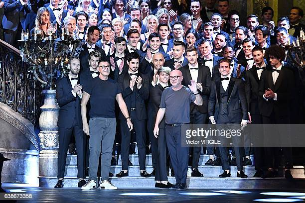 Stefano Gabbana and Domenico Dolce walk the runway at the Dolce Gabbana show during Milan Men's Fashion Week Fall/Winter 2017/18 on January 14 2017...