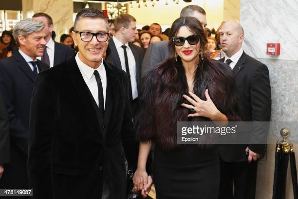 Stefano Gabbana and Monica Bellucci attend the photocall at Dolce Gabbana shop at TSUM on March 12 2014 in Moscow Russia