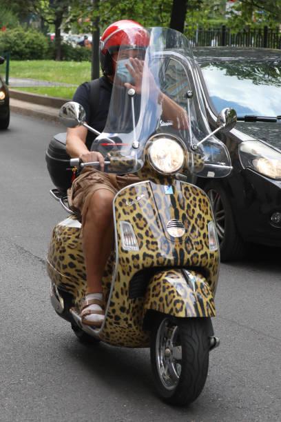 ITA: Stefano Gabbana Rides His Vespa In Milan