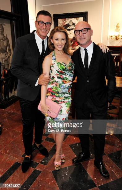 Stefano Gabbana Kylie Minogue and Domenico Dolce attend the opening of the new Dolce Gabbana men's store with a preview of the Summer 2014 Tailoring...