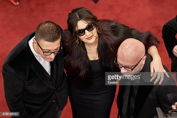 Stefano Gabbana Monica Bellucci and Domenico Dolce attend the photocall at Dolce Gabbana shop at TSUM on March 12 2014 in Moscow Russia