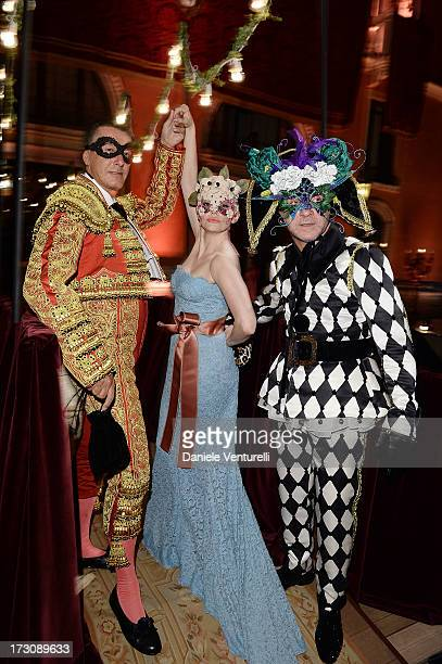 Stefano Gabbana Rose McGowan and Domenico Dolce attend the 'Ballo in Maschera' to Celebrate DolceGabbana Alta Moda at Palazzo Pisani Moretta on July...