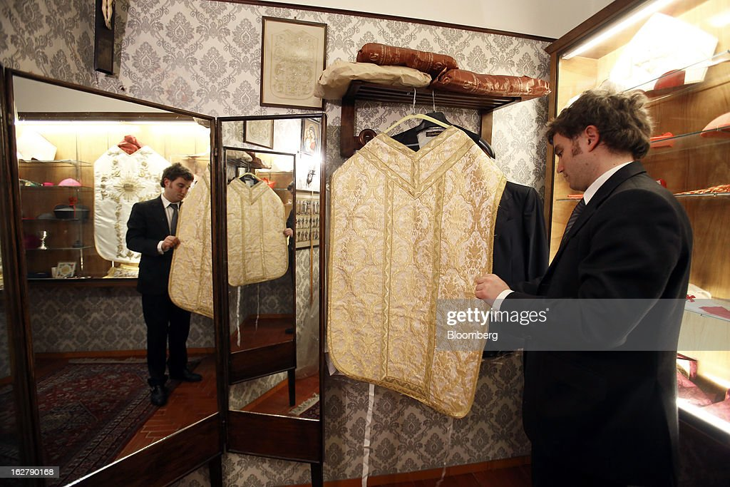 Stefano Gammarelli, an ecclesiastical tailor at Gammarelli, inspects a clerical chasuble as he works inside his family's store in Rome, Italy, on Friday, Feb. 22, 2013. Gammarelli was founded in 1797 under Pope Pius VI as tailors to the clergy, and lists other papal customers as John Paul I, Paul VI, and John XXIII. Photographer: Alessia Pierdomenico/Bloomberg via Getty Images