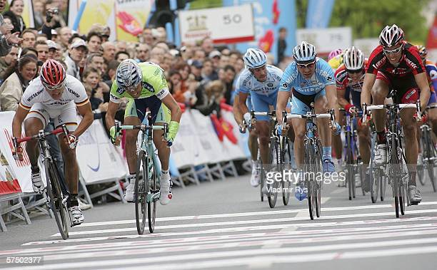 Stefano Garzelli of Italy and Liquigas crosses first the finish line followed by Gerald Ciolek of Germany and Wiesenhof finishing 2nd and Danilo...