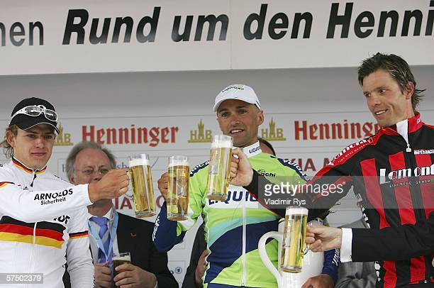 Stefano Garzelli of Italy and Liquigas finishing first Gerald Ciolek of Germany and Wiesenhof finishing 2nd and Danilo Hondo of Germany and Lamonta...