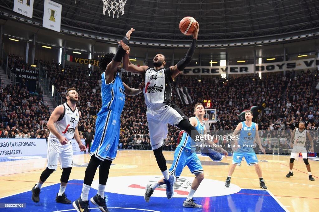 Stefano Gentile (L) and Marcus Slaughter (R) of Segafredo competes with Henri Sims (L) Travis Diener (C) and Drake Diener (R) of Vanoli during the LBA LegaBasket of Serie A match between Virtus Segafredo Bologna and Vanoli Cremona at PalaDozza on December 3, 2017 in Bologna, Italy.
