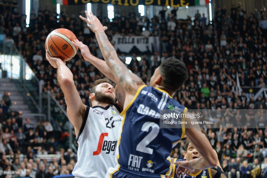 Stefano Gentile of Segafredo competes with Diante Maurice Garrett of Fiat during the LBA LegaBasket of serie A match between Virtus Segafredo Bologna and Auxilium Fiat Torino at PalaDozza on December 17, 2017 in Bologna, Italy.