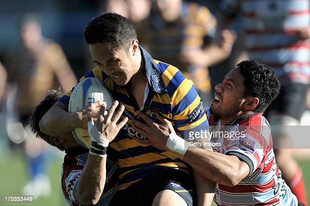 Stefano Hunt of Sydney Uni looks to braek through tackles during the round 16 Shute Shield match between Sydney Uni and Southern Districts at North...