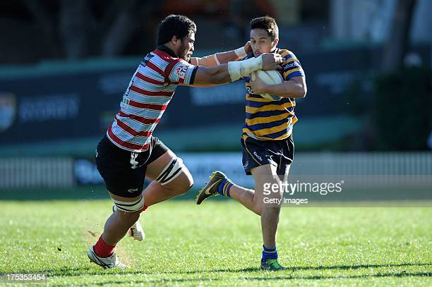 Stefano Hunt of Sydney Uni looks to break through a tackle during the round 16 Shute Shield match between Sydney Uni and Southern Districts at North...