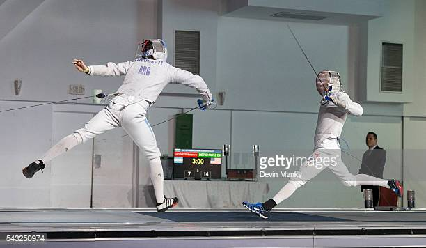Stefano Ivan Lucchetti of Argentina attacks Daryl Homer of the USA in the gold medal match during the Team Men's Sabre event The USA would go on to...