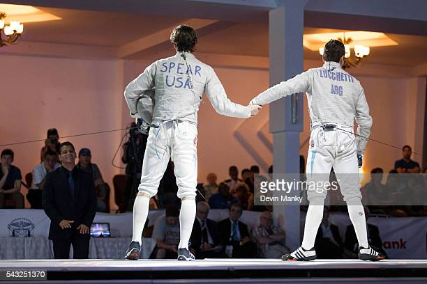 Stefano Ivan Lucchetti of Argentina shakes hands with Jeff Spear of the USA in the gold medal match during the Team Men's Sabre event The USA would...