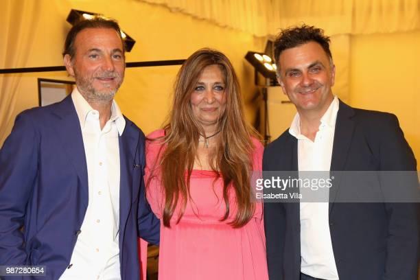 Stefano Maccagnani Paola Emilia Monachesi and Adriano Franchi attend Sfilata AU197SM AltaRoma on June 29 2018 in Rome Italy