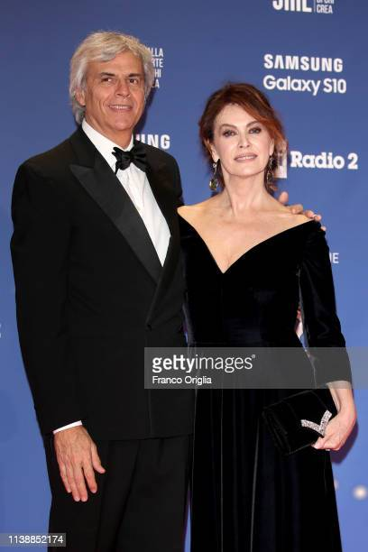 Stefano Mainetti and Elena Sofia Ricci walk a red carpet ahead of the 64 David Di Donatello awards ceremony Red Carpet on March 27 2019 in Rome Italy